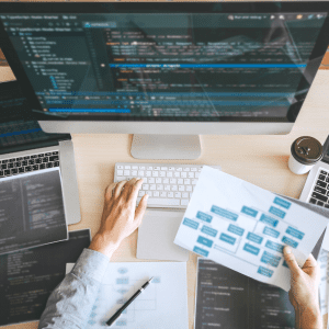 Professional Developer programmer working a software website design and coding technology, writing codes and database in company office, Global cyber connection technology; blog: why custom website design matters